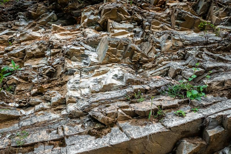 The texture of hewn stone, the edge of the destroyed rock.  royalty free stock image