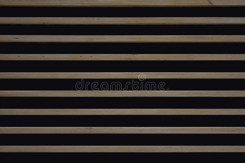 Texture of a horizontal wooden slats. From exterior of a building. Urban pattern for a background royalty free stock image