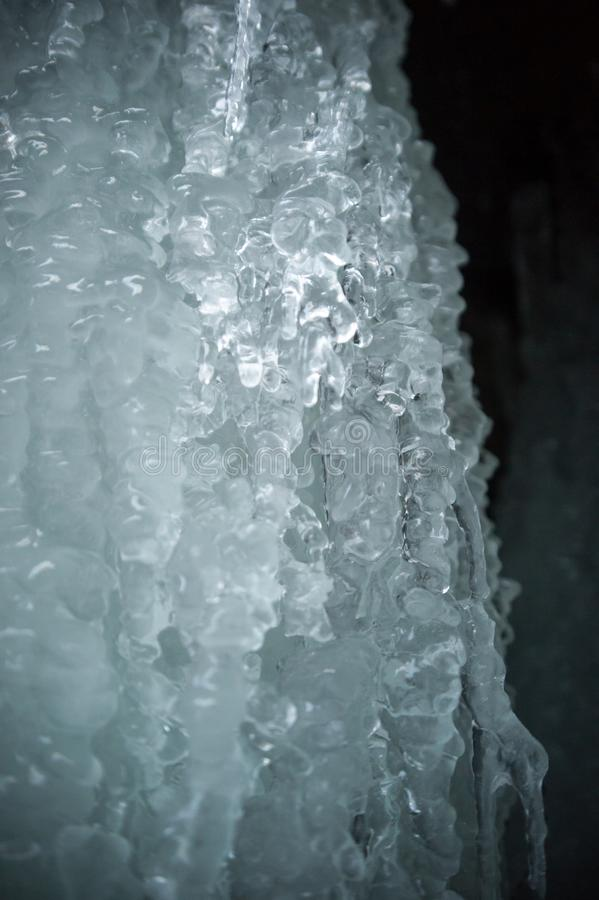 Texture of ice on a frozen waterfall royalty free stock photography