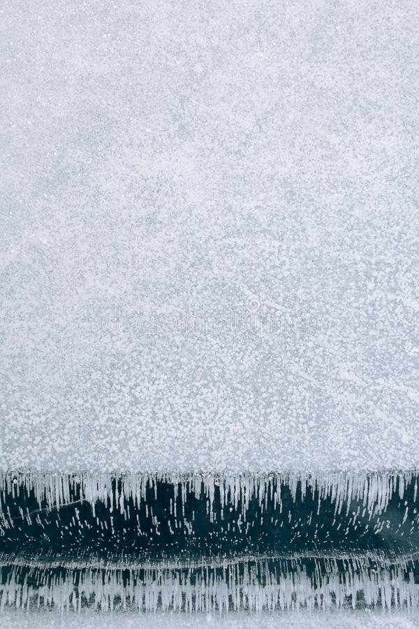 Texture of ice and snow. In winter royalty free stock image