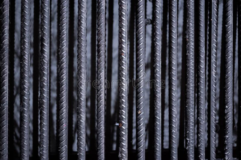 The texture of the iron bars. Wet and raw bars stock images
