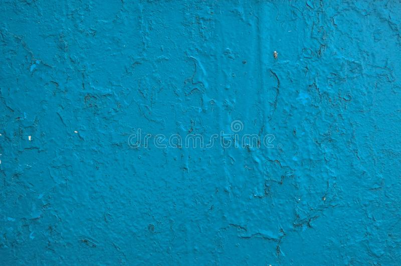 The texture of the iron metal painted blue paint shabby old shabby scratched cracked ancient metal sheet wall. The background stock image