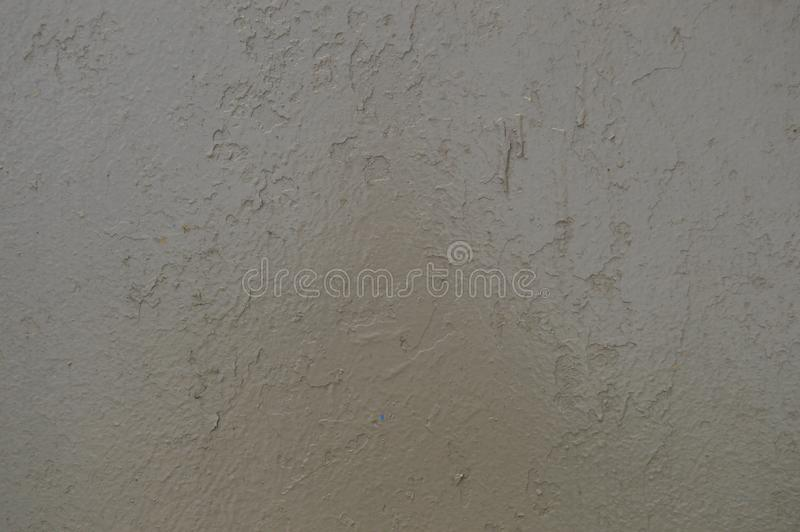 Texture of iron metal painted gray peeling paint of old battered scratched cracked ancient rusty metal sheet wall with corrosion. royalty free stock photos