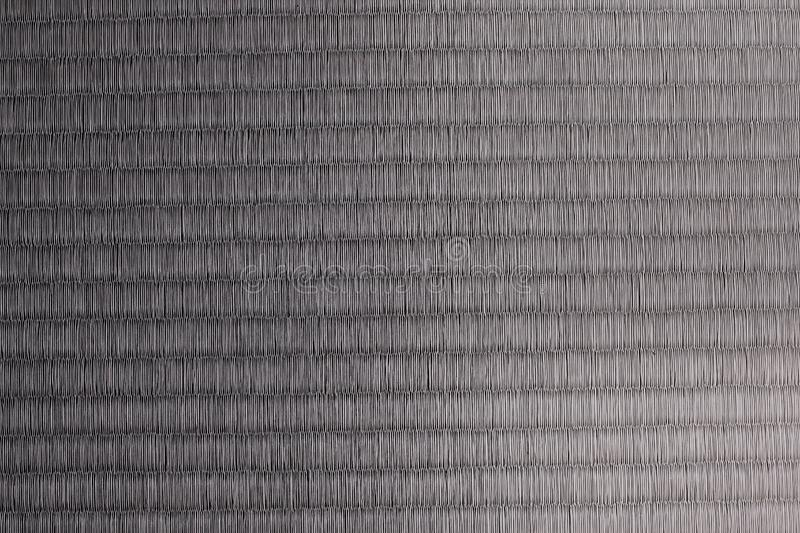 Texture of Japanese tatami mat - gray tone. The top view of a woven traditional Japanese tatami mat stock photography