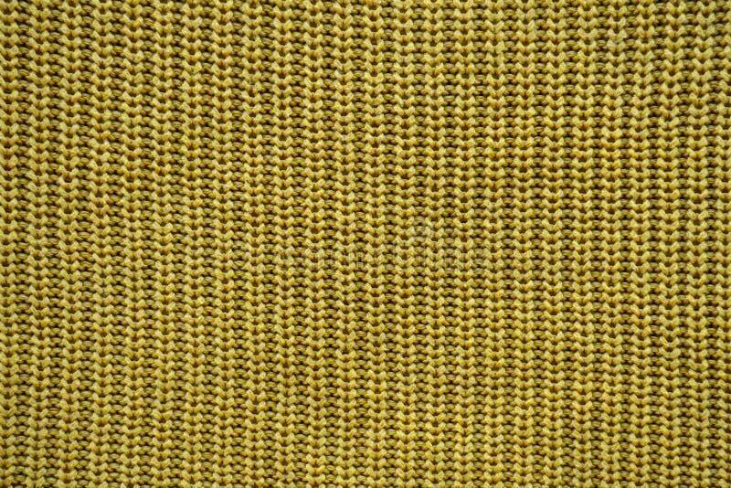 Texture jaune d'un modèle élastique anglais tricoté photo libre de droits