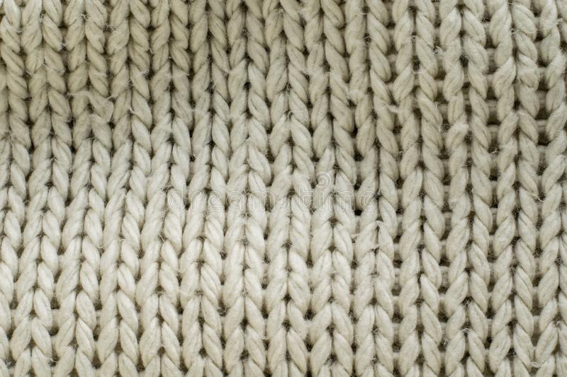 Texture of knit blanket. Large knitting. Plaid wool. Top view stock images