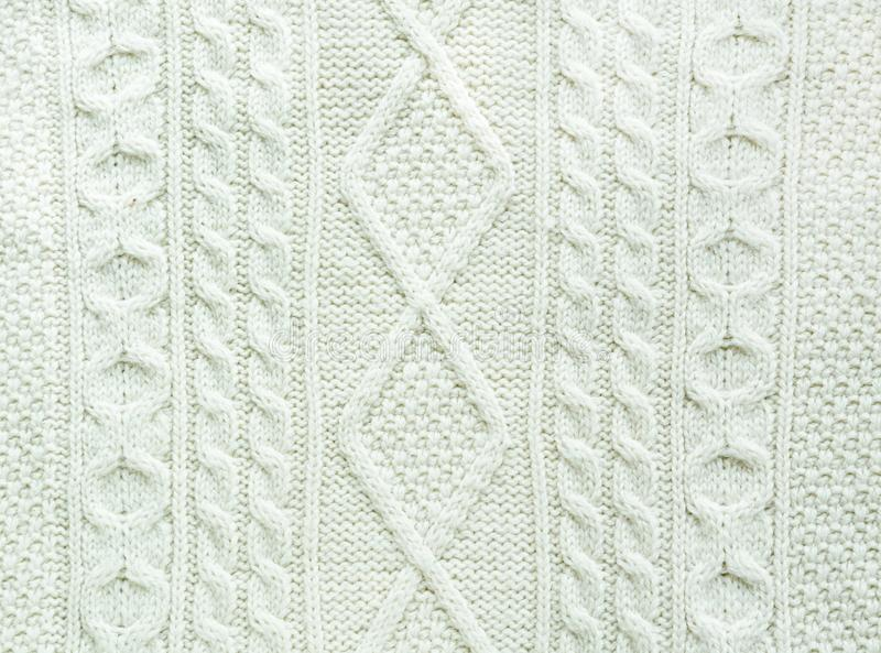 Texture of knitted handmade. Christmas white sweater close up. Wallpaper background. stock images
