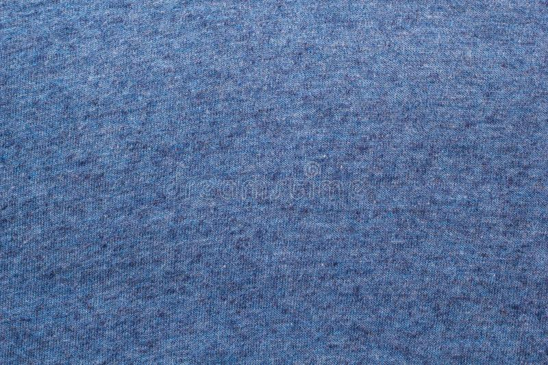 The texture of a knitted woolen fabric blue royalty free stock image