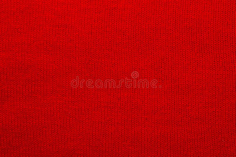 The texture of a knitted woolen fabric red royalty free stock image