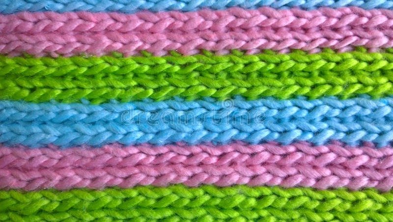 Texture of knitting wool. In blue, green and pink colors royalty free stock image