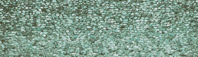 Texture large en pierre naturelle de Teal Fond panoramique de roche rugueuse rétro Long contexte de cru photos stock