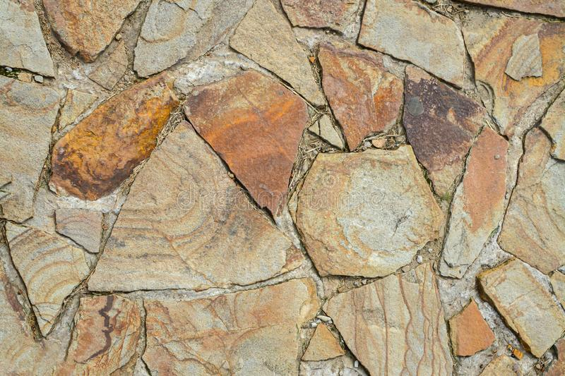 Texture of large flat stones. Abstract natural background. The concept of masonry made from natural, unprocessed stones royalty free stock photography