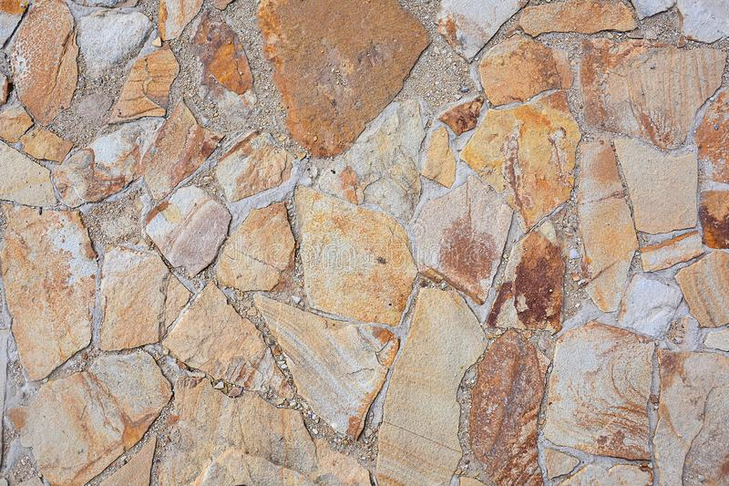 Texture of large flat stones. Abstract natural background. The concept of masonry made from natural, unprocessed stones stock photos