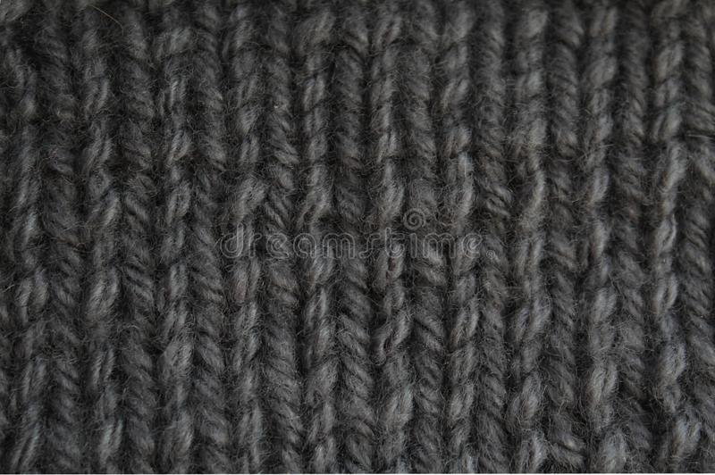 Texture large gray knit of wool thread background. Texture, knit, knitted, fabric, knitting, wool, background, yarn, design, pattern, sweater, fashion, material royalty free stock photo