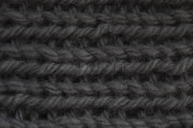 Texture large gray knit of wool thread background. Texture, knit, knitted, fabric, knitting, wool, background, yarn, design, pattern, sweater, fashion, material stock photo