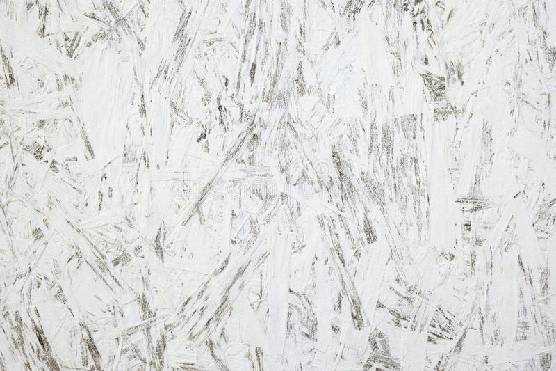 Texture of wood chipboard painted white background. Texture of large wood chipboard painted white background royalty free stock photography