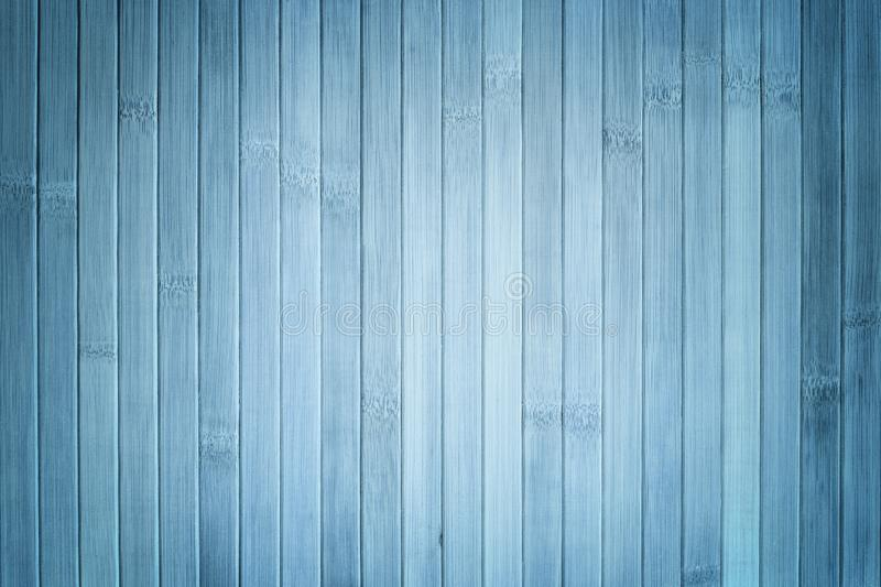 Texture of light blue wooden background. Bamboo , wood backdrop with vignette. Texture of light blue wooden background. Bamboo traditional napkin for a table stock photography