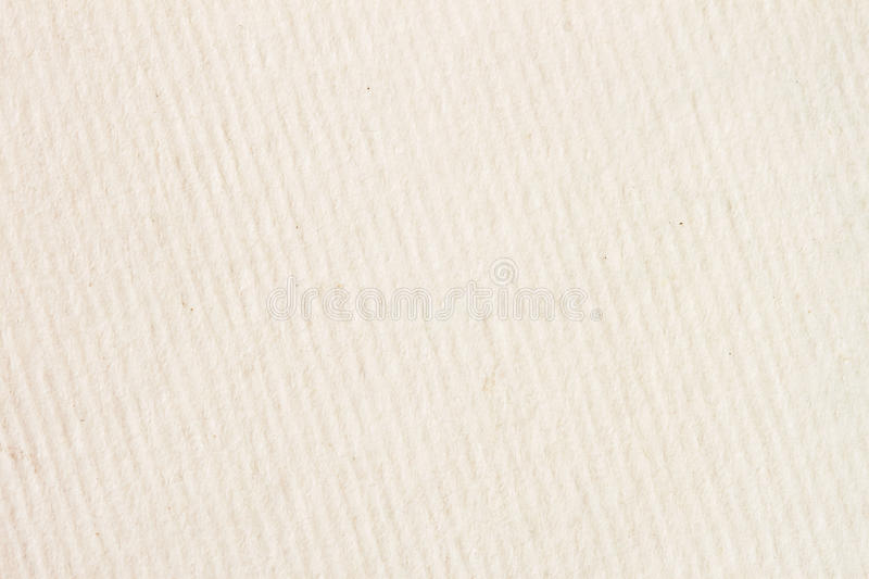 Texture of light cream in a diagonally strip paper with small inclusions for watercolor and artwork. Modern background royalty free stock photo