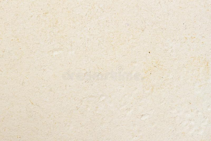 Texture of light cream paper, background for design with copy space text or image. Recyclable material, has small. Texture of light ecological cream paper stock photos