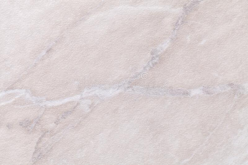 Texture of light gray marble with white lines of a pattern, macro background. Ivory color stone backdrop. From mineral tile, closeup stock photography