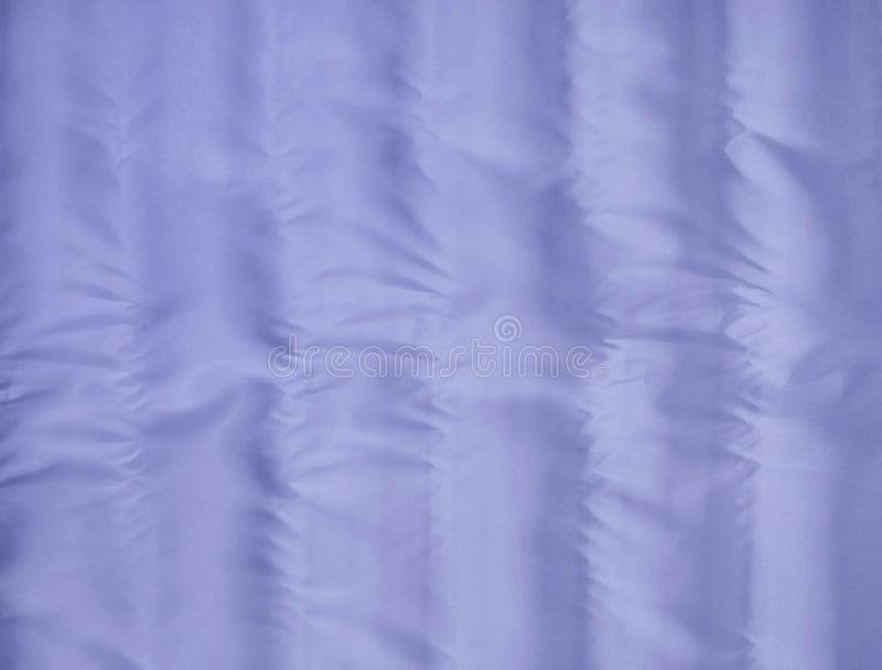 The texture of light purple fabric is slippery and shiny for the background stock images