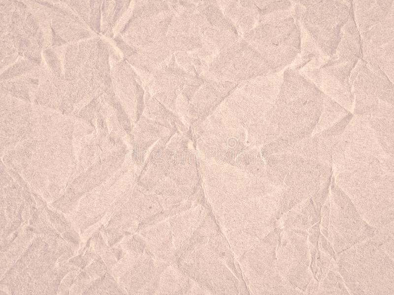 Texture of light red crumpled craft paper. Texture for design stock photos
