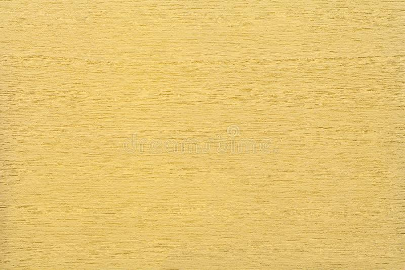 Texture of light yellow clean woody background, closeup. Structure of the painted wood, plywood backdrop stock images