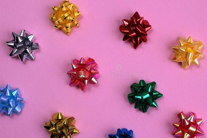 Texture of a lot of festive bows in the form of a star on a pink background. Bow, background picture, banner, birthday, celebration, chic, christmas, decor stock images