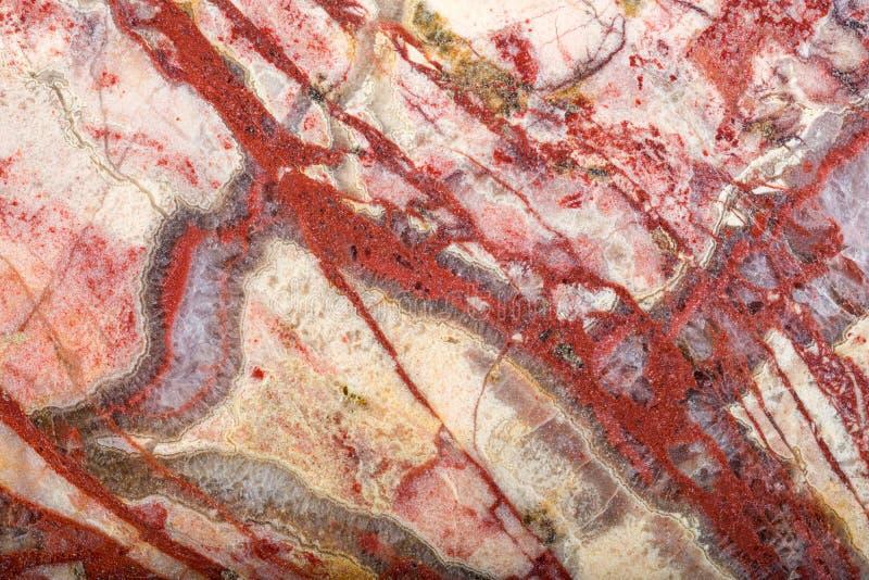 Texture macro of dark and light red jasper stock image