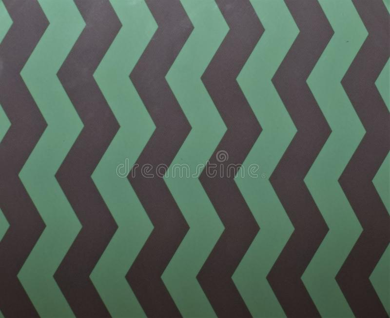 Texture many zig zag pattern, green and gray color, vertical line. Simple background texture many zig zag pattern, green and gray color, vertical line. Creative stock photos