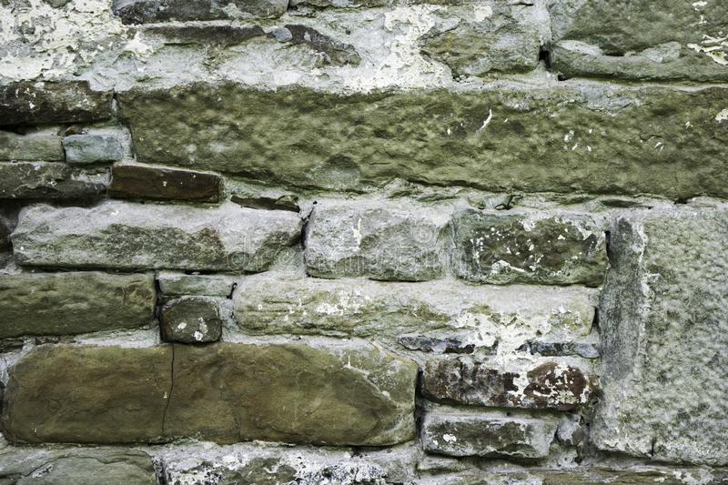 Texture of masonry, a fragment of a stone wall of an ancient temple of the 10th century, background, backdrop stock photos