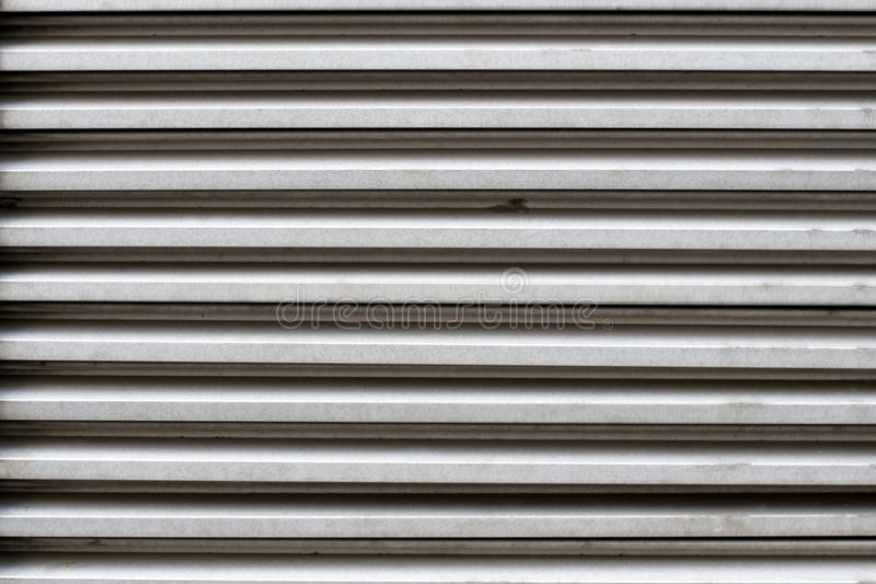 Texture of metal blinds for a door or window in gray colour stock photos