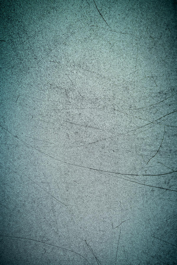 Texture of metal with long black scratches on the surface. Blue or green or turquoise and gray metallic Vertical background stock photography