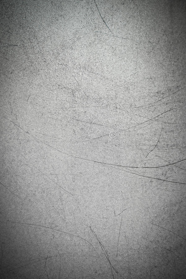 Texture of metal with long black scratches on the surface. Gray metallic background royalty free stock images