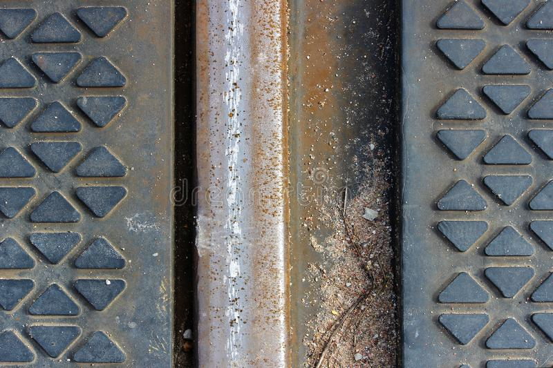 the texture of the metal rails and the rubber coating on the railway crossing royalty free stock images