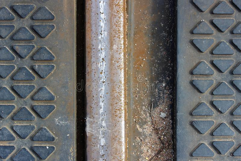 the texture of the metal rails and the rubber coating on the railway crossing royalty free stock photography