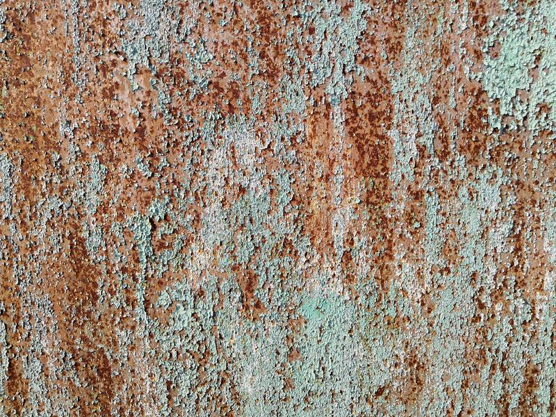 Texture of metal rusty wall brown blue background. Paint rusty textured metal background. Cracked paint, rust surface royalty free stock photos