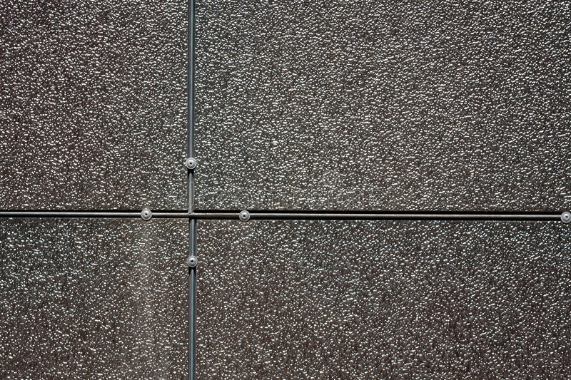 Texture of metal. Tiles on the wall with metal texture stock images