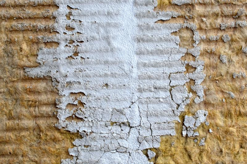 Texture of mineral wool to insulate the walls of the facade of buildings. Pieces of cement or plaster royalty free stock images