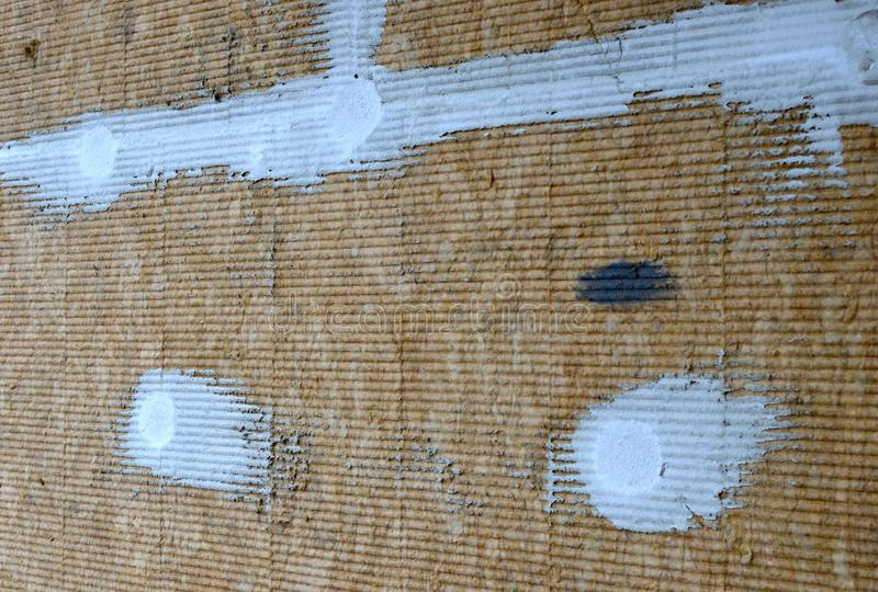 Texture of mineral wool to insulate the walls of the facade of buildings. Pieces of cement or plaster stock images