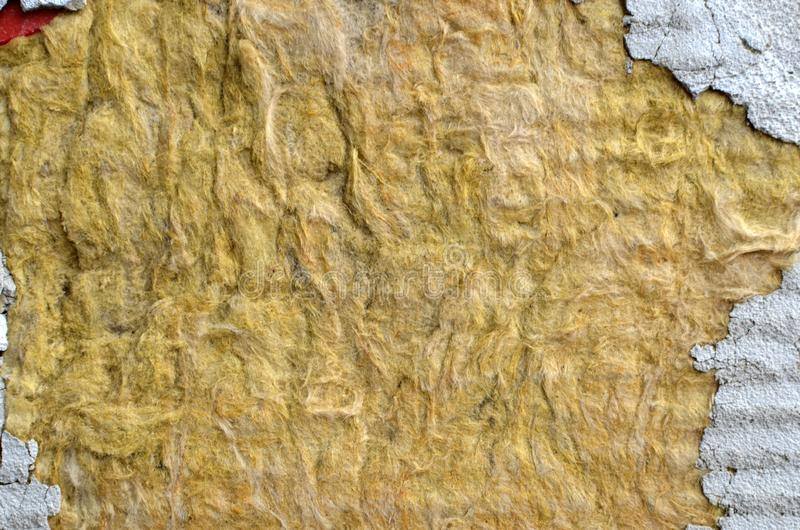 Texture of mineral wool to insulate the walls of the facade of buildings,. Pieces of cement or plaster royalty free stock photography