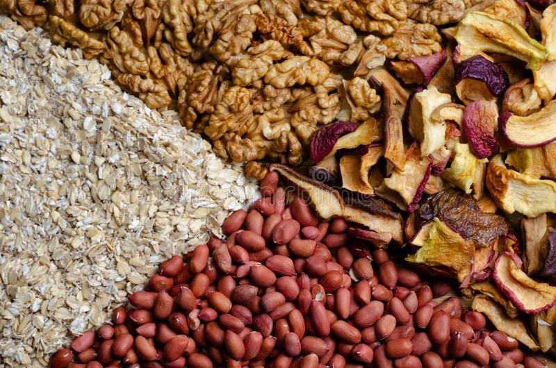 Texture of a mixture of dried fruits nuts and cereals stock photos