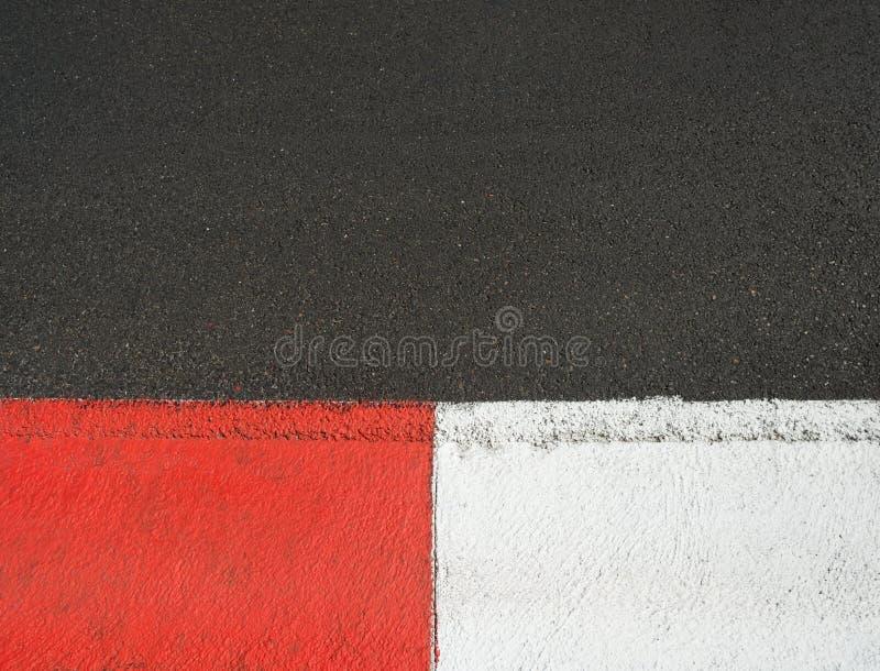 Texture of motor race asphalt and curb Grand Prix circuit royalty free stock photos