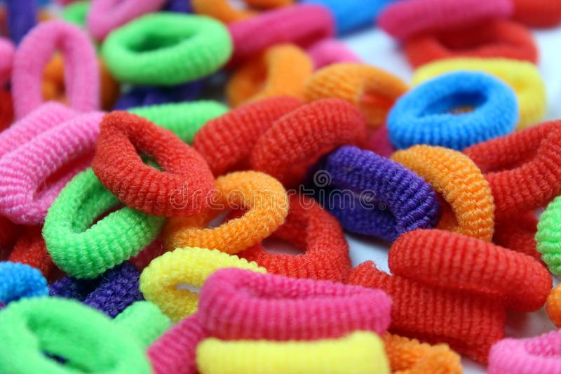 Texture multi-colored elastic bands for small hair stock photos
