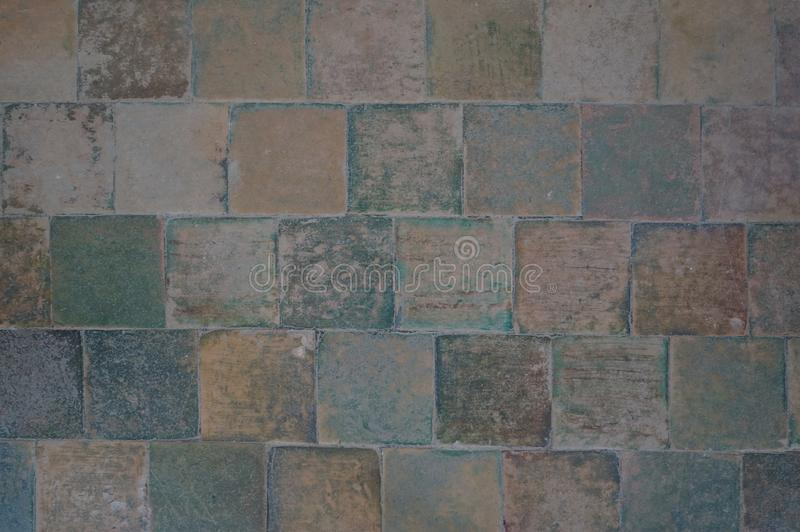 Texture of a multi-colored floor tiles of ancient building. Texture of a multi-colored floor tiles of an ancient building stock images