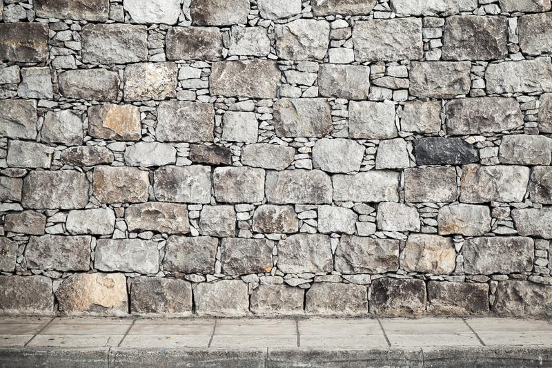 Texture, mur en pierre gris et carrelage de plancher photographie stock