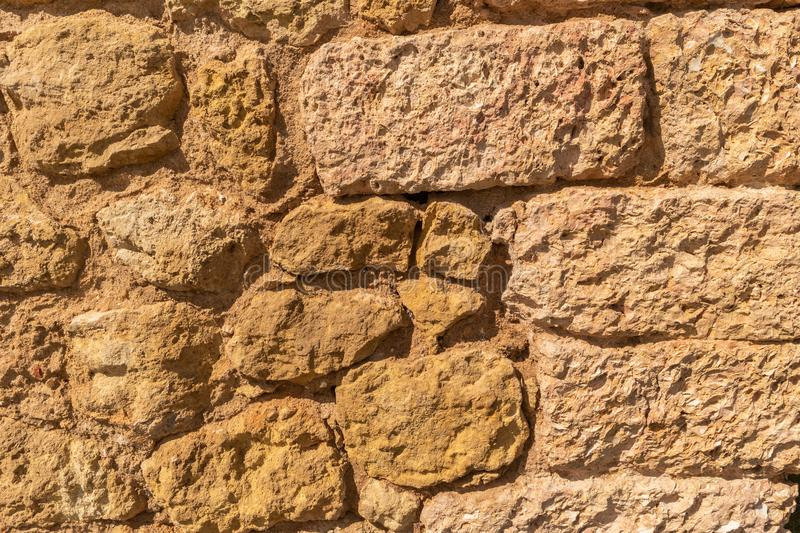 Texture of natural beige limestone wall. Copy space stone backgr. Ound royalty free stock photography