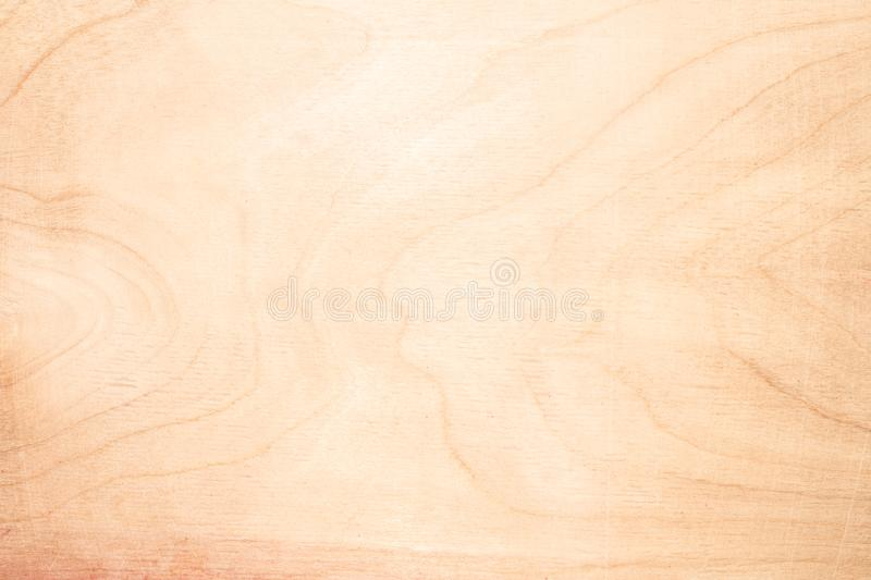 Texture of natural birch plywood, the surface of the wood has been rubbed with sandpaper and scratched. A lot of fiber and small chips, close-up abstract stock photography