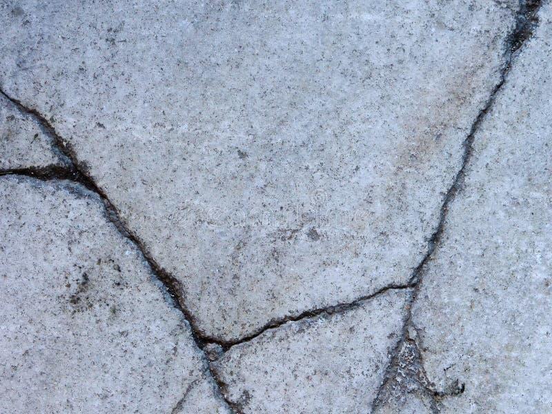 Texture of natural gray granite with deep cracks royalty free stock image