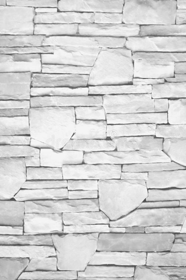 Texture natural layer seamless wall of gray or white stone for background , horizontal patterns stock photo